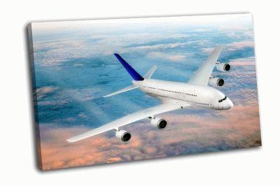 Картина самолет над облаками