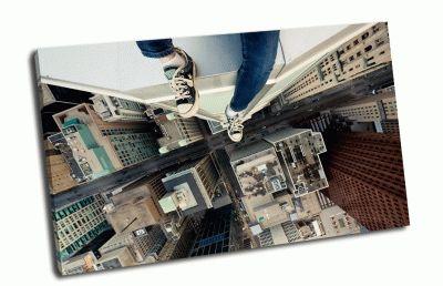 Картина сидя на краю небоскреба